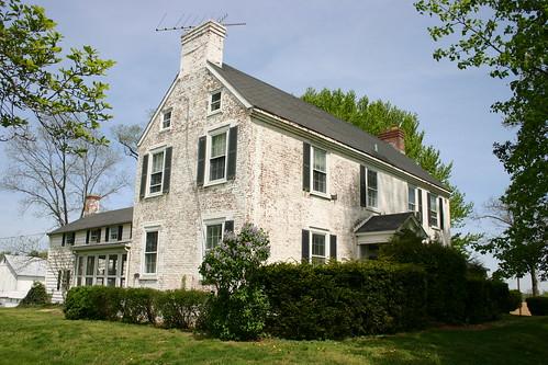 Grove Farm manor house. All white brick estate set amongst beatiful landscaping