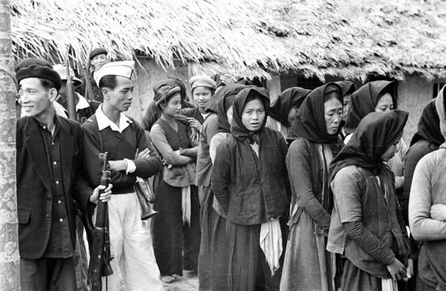 North Vietnam 1950 - Women and men gathered in Catholic village of Vinh Yen