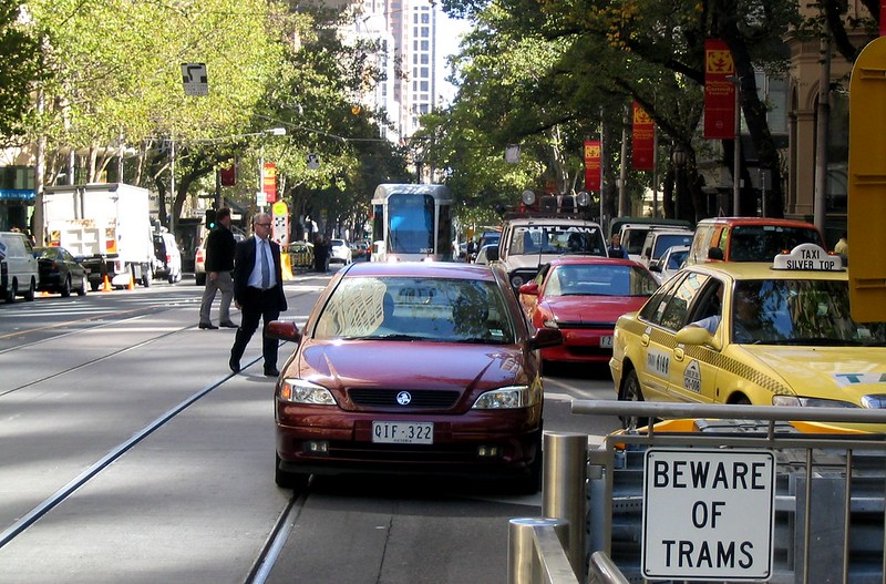 Tram in traffic, Collins Street approaching Spring Street (March 2004)