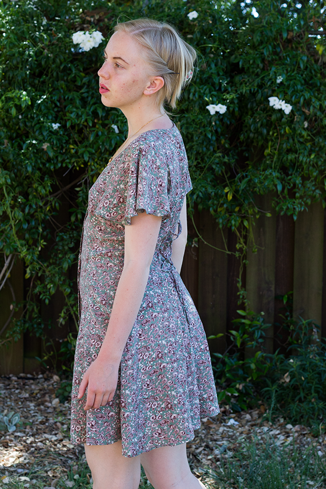 messy updo for short hair, green floral dress with cropped trumpet sleeves