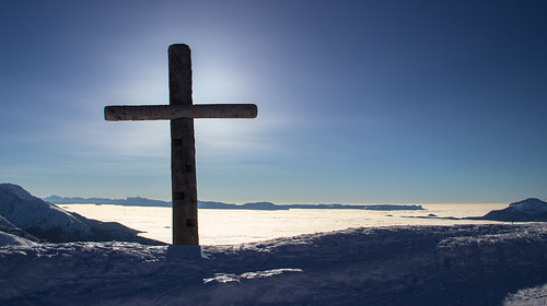 What a wonderful day for skiing. cloud-sea just under the cross and the sun.