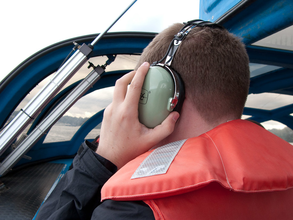 Ken wearing headset on boat tour