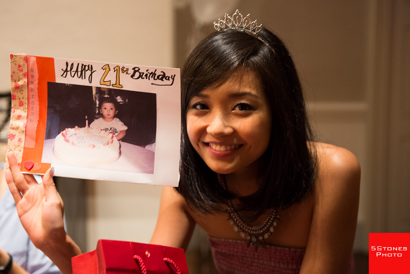 Gwen holding up a photo of her as a baby during her 21st birthday coming of age party!