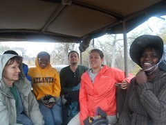 Phumelle (seated right), a local and research leader at the base camp in Swaziland, rides with students on their way to Mlawula Nature Reserve to check Sherman traps.