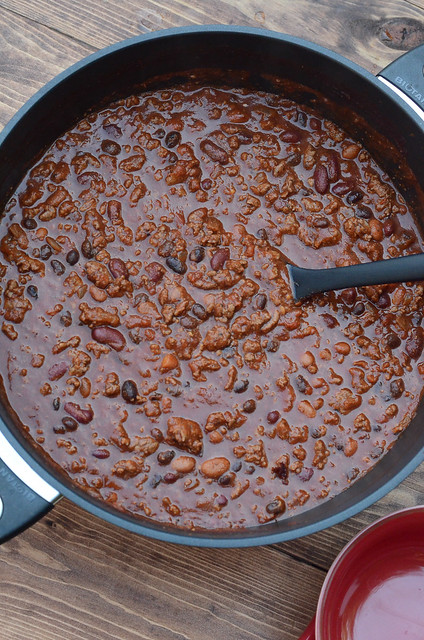 An over the top shot of Halftime Chili in a pot with a spoon.