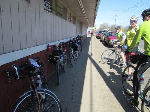 Line of bikes in Gaston.  Jeff A eating his signature pepperoni stick.