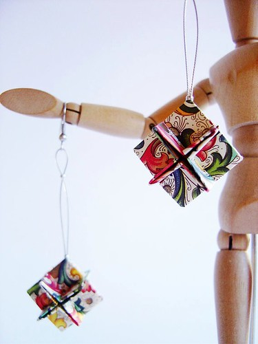 origami paper earrings on wooden stick figure