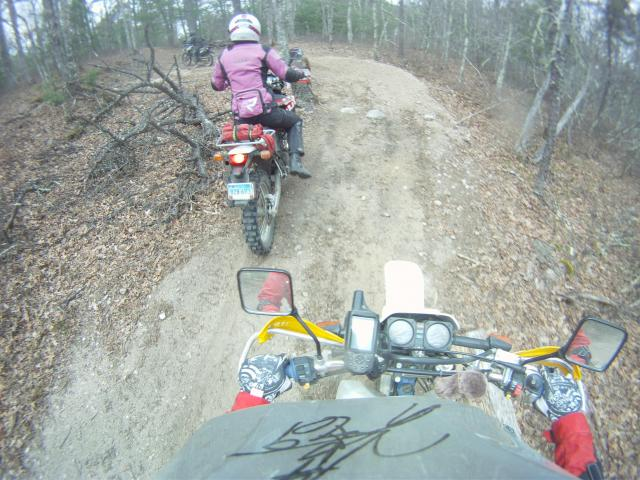 me riding Andy's '08 Husky TE610 and he on my DR350...note the stuffed hedgehog!