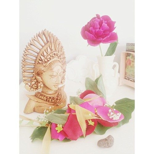 Earlier today I told John all about the beautiful way the Balinese people leave offerings/blessings everywhere. Later he went out into our yard and gathered up petals and leaves and created this gorgeous offering/blessing for me. How sweet is that? I put