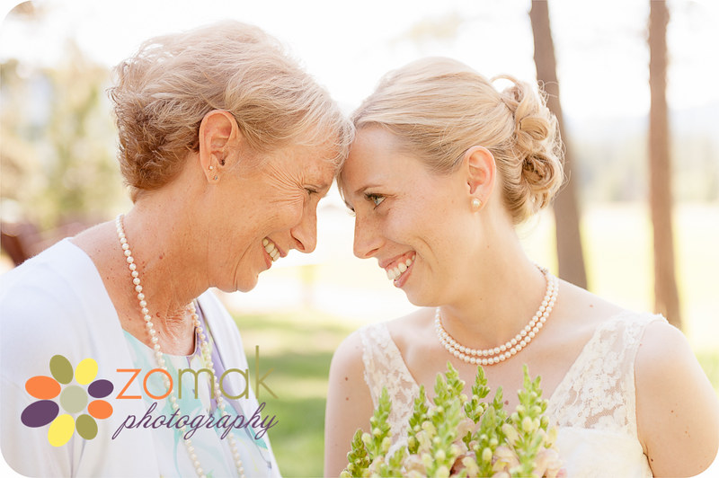 Bride and her mother have a special moment before her Seeley Lake wedding.
