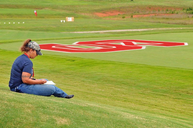 Turfgrass Field Day attendee takes a break between seminars and goes over her notes.