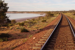 The Adelaide Darwin railway line passing along the edge of Lake Hart north of Port Augusta in South Australia.