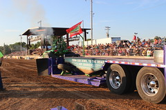 auto racing(0.0), festival(0.0), racing(0.0), tractor pulling(1.0), vehicle(1.0), transport(1.0), race(1.0), fair(1.0), race track(1.0),