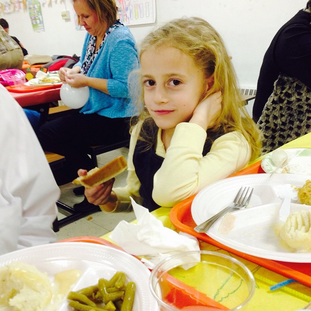 We had Autumn's Thanksgiving Feast at school tonight and she was eating her pumpkin pie like it was a slice of pizza!! 😂😂😂 oh, that girl! Such a silly willy, she is!!!