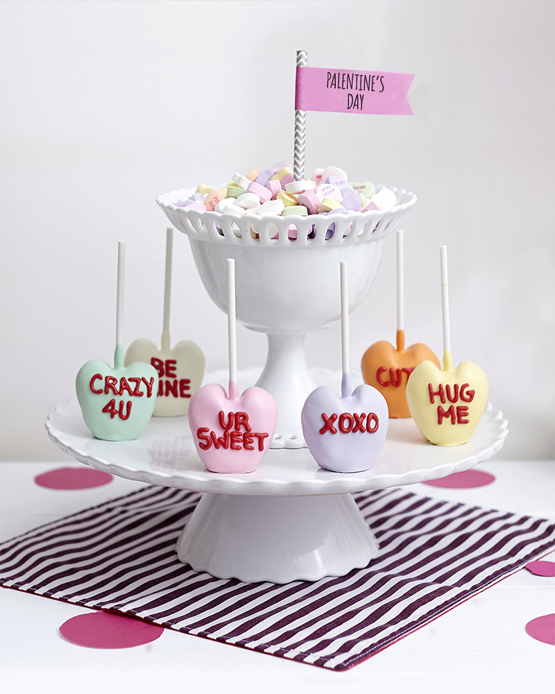 Valentine's Day conversation heart brownie pops on a white tiered platter