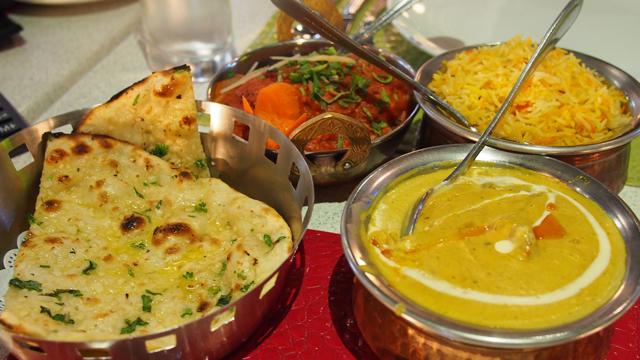 Our feast of garlic naan, lamb korma, murgh tikka masala and saffron rice