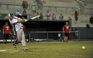 Coast Guard Petty Officer 1st Class Robert D. Somers, a damage controlman at Air Station Clearwater, Fla., hits a pitched ball during the VETSports 2nd Annual St. Petersburg, Fla., Softball Series at Al Lang Stadium on Saturday, Dec. 6, 2014. VETSports team members are disabled active and reserve veterans that participate in sports, physical activity and community involvement in an effort to ease the transition back to a civilian lifestyle. (U.S. Coast Guard photo by Seaman Meredith A. Manning)