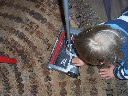 Using an Electric Sweeper (Photo from Confessions of a Montessori Mom Blog)