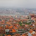 The Torre dos Clérigos overlooks the rooftops of Porto on a misty and wet day by B℮n
