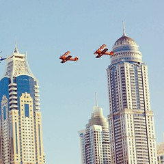 #vintage military #aeroplanes flying above #dubaimarina with the tallest residential tower in the world #PrincessTower #Dubai #uae. Now this is literally Modern Classic art.