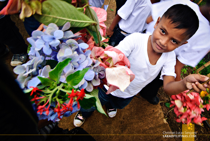 Students from Danag Elementary School Handing Out Flowers in Patikul, Sulu