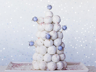 Doughnut tree made out of white powdered supgar donut holes for christmas winter wonderland centerpiece that you can eat.