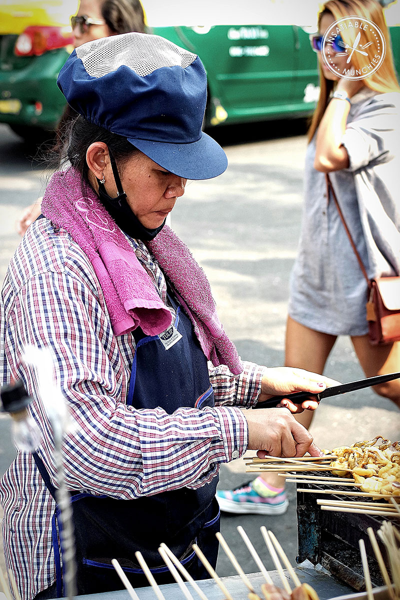 street food hawker selling grilled seafood