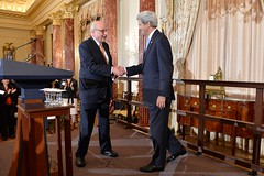 U.S. Secretary of State John Kerry shakes hands with Ambassador John Negroponte, Chairman Emeritus of the Council of the Americas Board of Directors, before addressing a joint reception in honor of the 46th Annual Washington Conference on the Americas and the U.S.-Caribbean-Central American Energy Summit, at the U.S. Department of State in Washington, D.C., on May 4, 2016. [State Department photo/ Public Domain]
