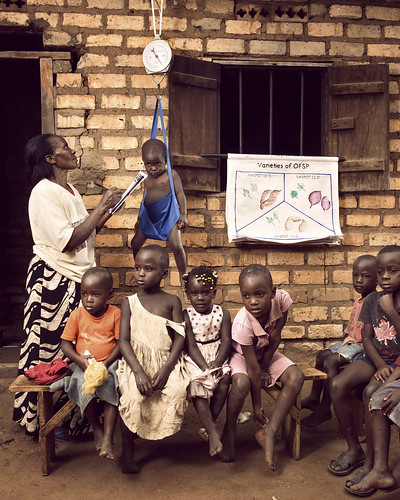 Agnes, surrounded by small children | by World Bank Photo Collection