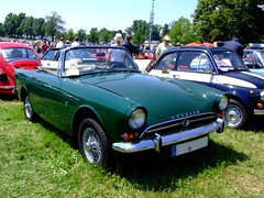 datsun roadster(0.0), automobile(1.0), vehicle(1.0), performance car(1.0), sunbeam tiger(1.0), antique car(1.0), classic car(1.0), vintage car(1.0), land vehicle(1.0), convertible(1.0), sports car(1.0),