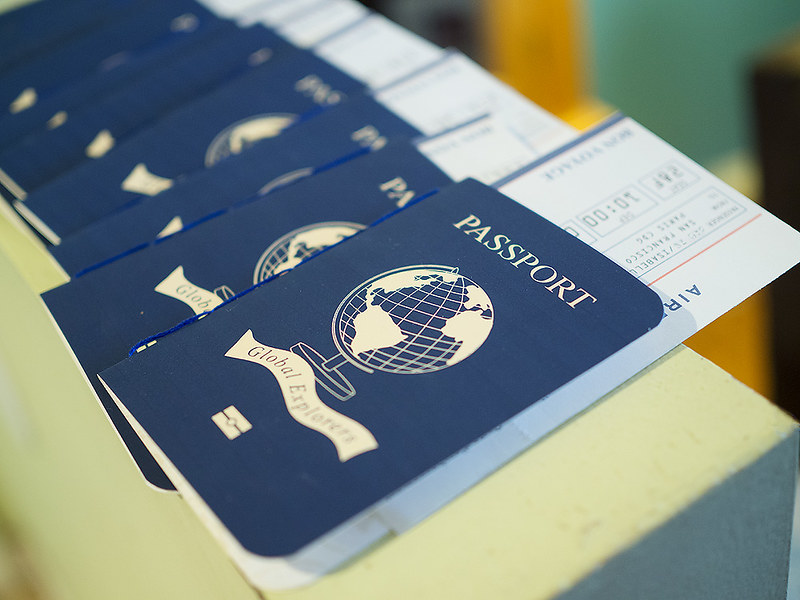 Passports and plane tickets for all the kids