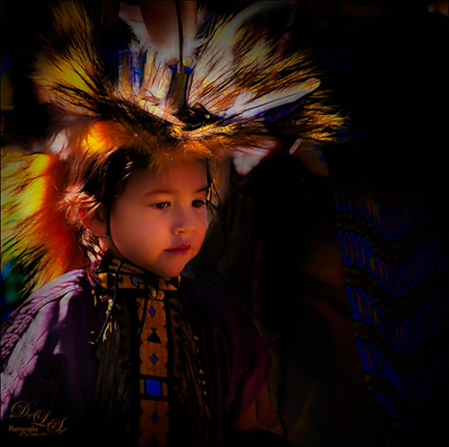 Image of a little Native American Girl with headress