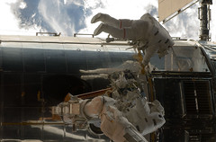 STS-125 MS5 Feustel and MS3 Grunsfeld during EVA1