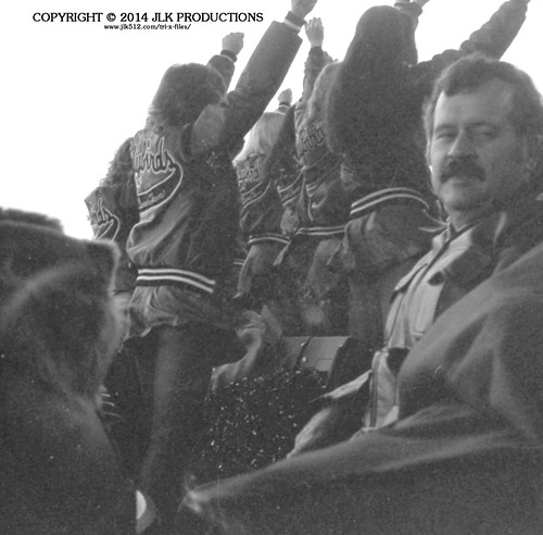 Tri-X Files 84_29.12a: Cheerleaders in the Stands and One Amused Fan