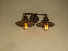 ceiling(0.0), chandelier(0.0), lamp(1.0), light fixture(1.0), sconce(1.0), metal(1.0), light(1.0), lighting(1.0),