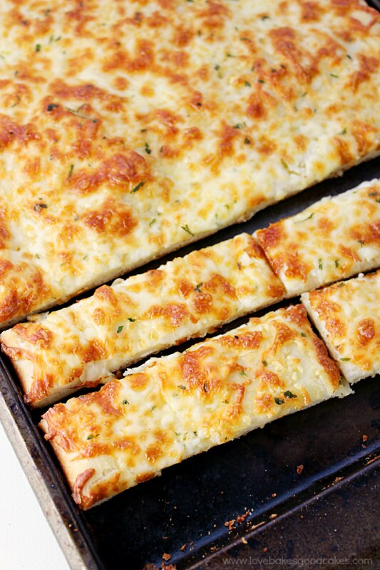Cheesy Bread sticks sliced in a baking pan.