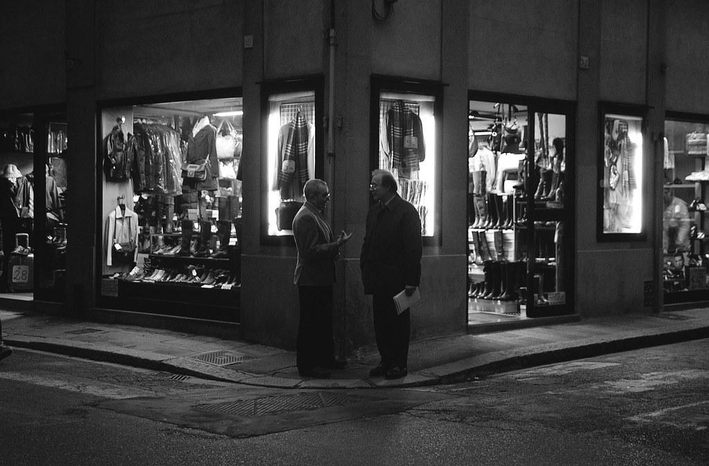 Men chatting on a corner, Florence