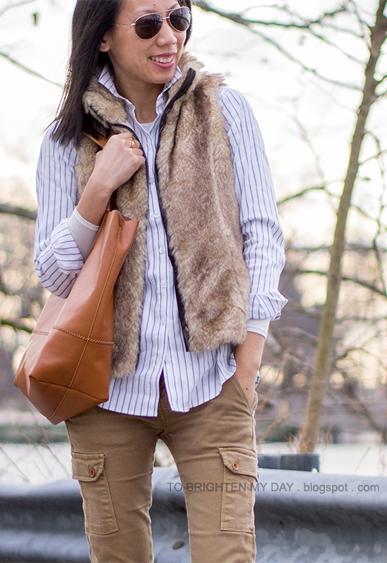 faux fur vest, striped button up shirt, cargo pants, cognac brown tote