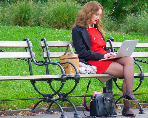 A sign of the times: nobody pays any attention to a beautiful laptop with a woman attached to it.