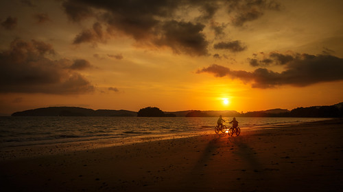 ocean travel family sunset sea summer vacation sky people sun holiday playing beach nature boys water girl beautiful bicycle silhouette kids youth sunrise children fun thailand happy coast sand child play outdoor soccer young lifestyle running tropical active bicyclebeach changwatkrabi tambonaonang