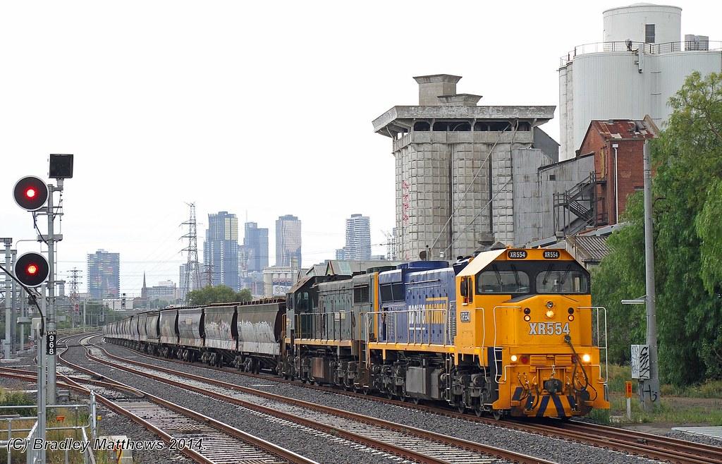 XR554-X43 with #9543 down empty PN grain from Kensington to Tottenham Yard via Nth Melbourne RRL at Sth Kensington (23/12/2014) by Bradley Matthews