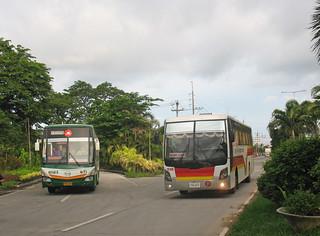 Photographed by John Ward on 8 July 2014. Baliwag Transit Inc Hino CXU-127 (8923) Victory 036410 1549 Northern Exp near McArthur Highway bridge, Tabang, on the Tabang Spur, Bulacan, Philippines.
