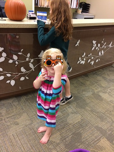 """Look at these silly glasses, Mama!"""