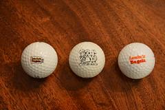 golf ball(1.0), golf equipment(1.0), circle(1.0), ball(1.0),