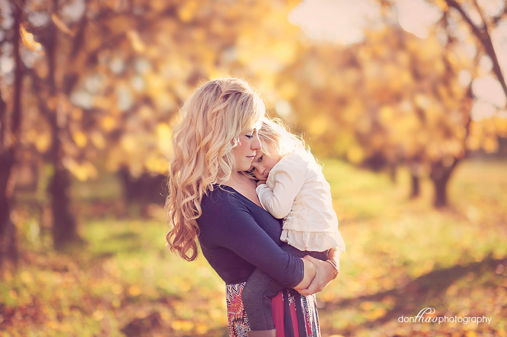 mother and daughter embrace in Michigan apple orchard photography