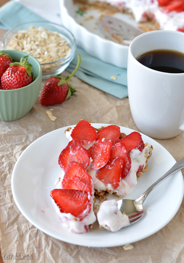 Strawberry Cheesecake Yogurt Tart with a Granola Crust! bethcakes.com