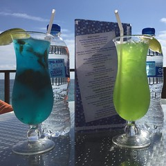 water(1.0), distilled beverage(1.0), liqueur(1.0), glass(1.0), green(1.0), blue hawaii(1.0), drink(1.0), cocktail(1.0), alcoholic beverage(1.0),
