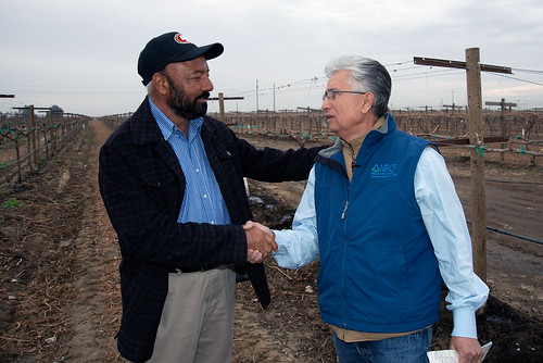 A man with a NRCS employee.