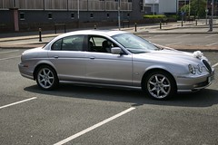 sports car(0.0), jaguar s-type(0.0), automobile(1.0), automotive exterior(1.0), executive car(1.0), wheel(1.0), vehicle(1.0), automotive design(1.0), rim(1.0), bumper(1.0), jaguar s-type(1.0), sedan(1.0), personal luxury car(1.0), land vehicle(1.0), luxury vehicle(1.0),