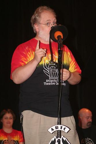 Daniel Taylor addresses the microphone.